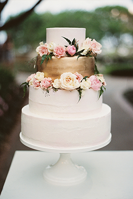 White buttercream wedding cake with metallic gold layer and floral accent in Dallas, Texas by After Yes